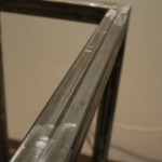 Sit/Stand desk welding frame close-up