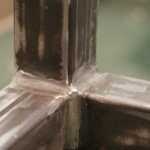 Sit/Stand desk welding frame extreme close-up 3 corner