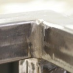 Sit/Stand desk welding frame extreme close-up corner